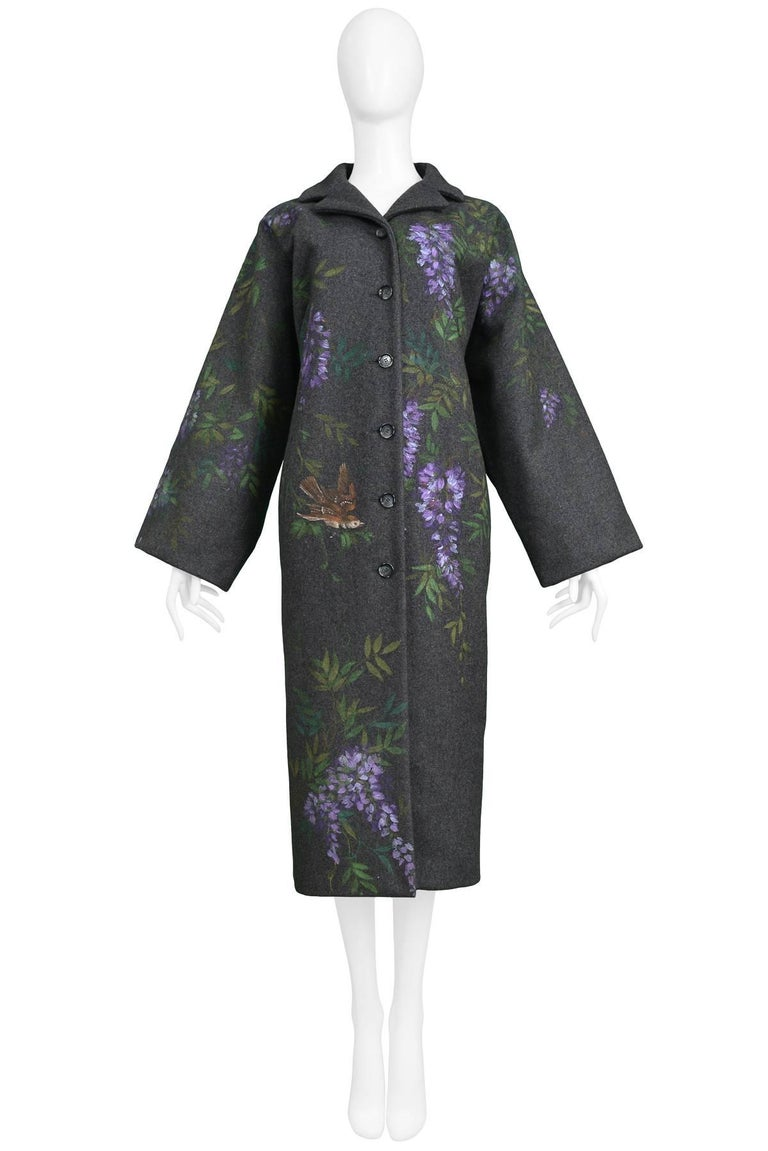 Vintage Dolce & Gabbana hand-painted flowers and birds on a grey wool kimono shaped coat. Fully lined and button front. Collection 1998.