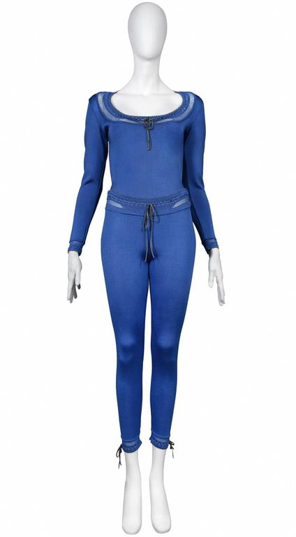 Vintage Azzedine Alaia blue rayon knit bodysuit and leggings ensemble. Ties at neckline, cuffs and waist band. Open knit lace details.