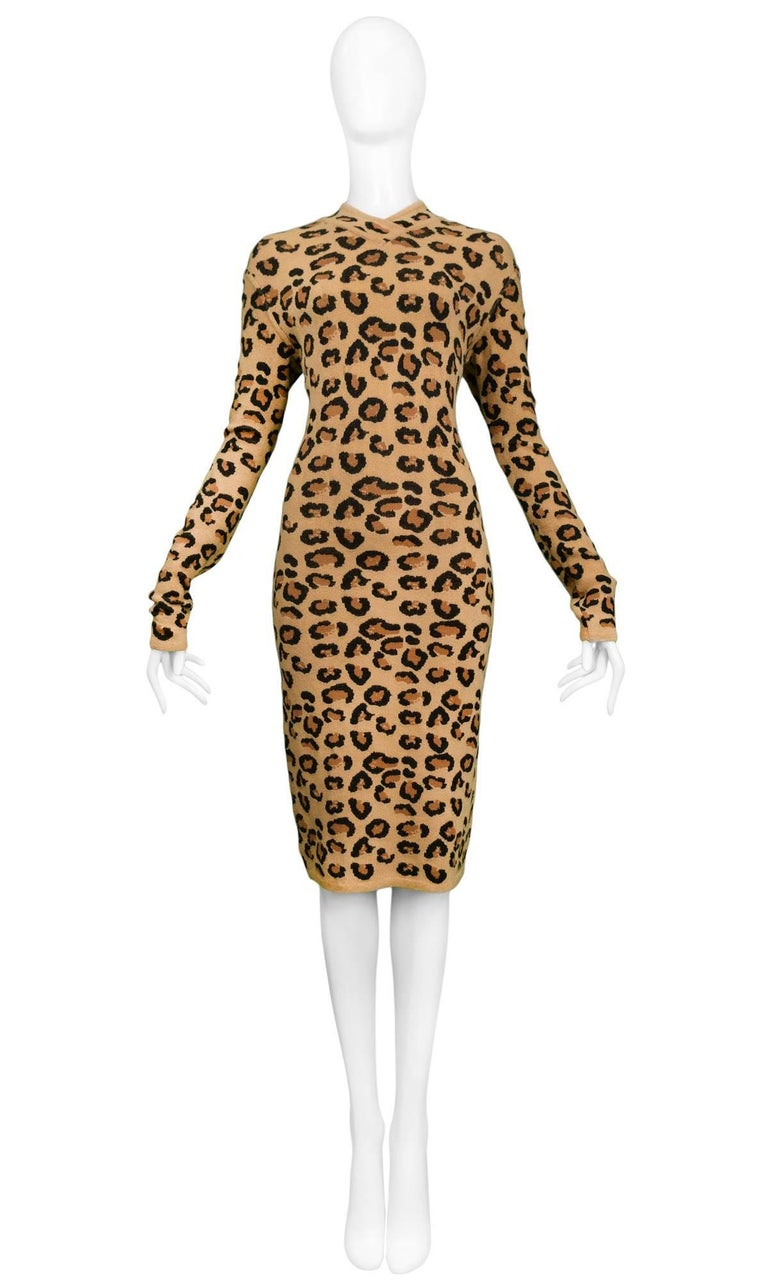 Beige and black Alaia knit leopard print body-con dress with long sleeves, knee length skirt, zipper at center back. Never worn. Excellent condition. Collection AW 1991.