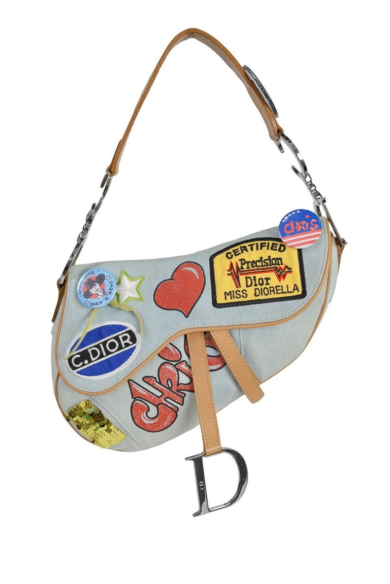 Iconic John Galliano for Christian Dior light denim 'Speedway' Saddle bag with decorative pins, patches & graffiti detail. Limited edition.