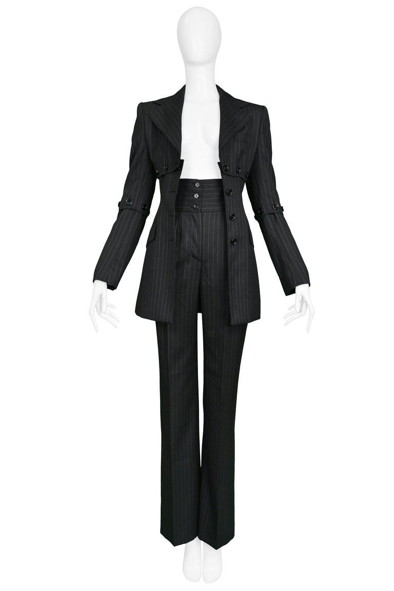 Vintage Dolce & Gabbana cashmere blend charcoal pinstripe pantsuit featuring high waisted pants with 3 button closure and button detail under chest, back & arms.   Excellent Condition.   Size - JACKET: 40, PANTS: 38