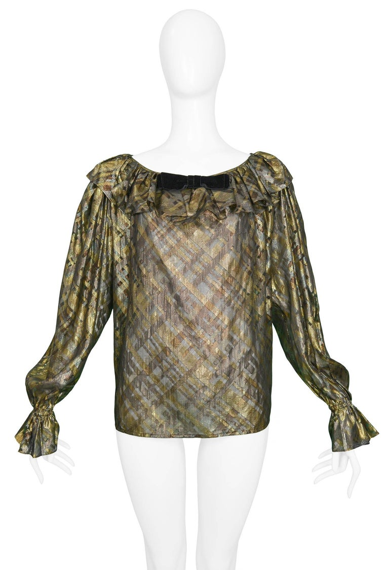 Vintage Yves Saint Laurent blouse featuring a metallic print of gold & black plaid, blouson sleeves and a ruffle collar with velvet bow detail.  Excellent Condition.   Size: 44