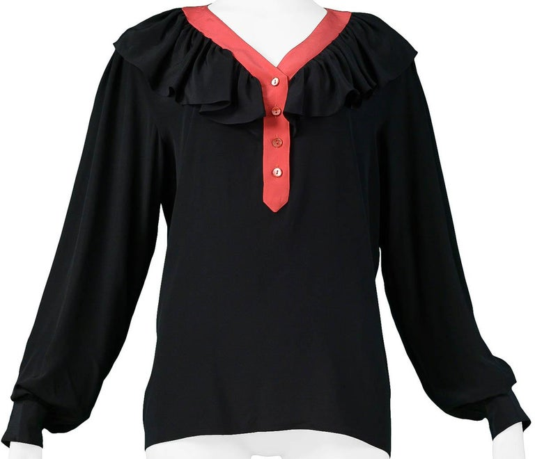 Vintage Yves Saint Laurent black silk blouse with red trim, button front, and ruffle collar.  Excellent Condition.   Size: 42