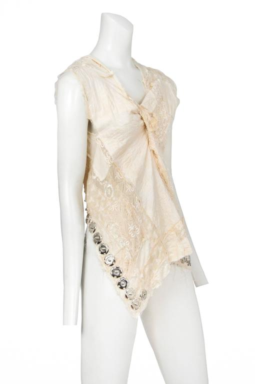 Vintage Junya Watanabe cream embroidered abstract sleeveless top featuring exposed snaps along the hem. Runway piece from the Spring 2005 Collection.