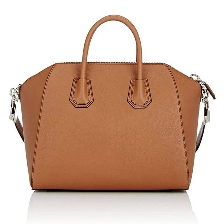 Givenchy Antigona Medium Calfskin Duffle Shoulder Bag, Caramel  Walk around in style with this fashionable and gorgeous duffle from Givenchy. Immaculately crafted in Italy, the calfskin leather exudes class and sophistication while a smartly