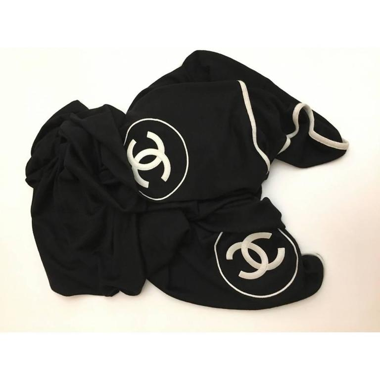Chanel Cashmere Silk CC Logo Stole, Black  This gorgeous piece of art is featured in 70% cashmere and 30% silk blend. This scarf drapes beautifully and displays two large interlocking CC logos on opposite corners. The stole has no sign of wearing,