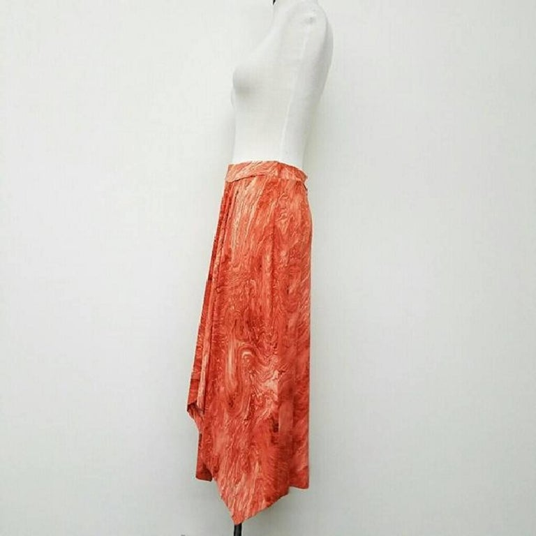 Michael Kors Marble Print Skirt  Brand new. Never used. Tags still attached  Type:Skirts Size:6 (S, 28) Color:orange Brand:Michael Kors Style/Collection:Michael Kors Marble Print Skirt