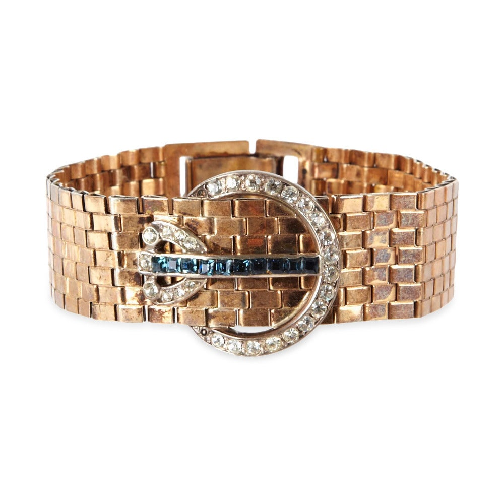 Kreisler retro articulated link bracelet of pink gold metal links, and crystal pave  with invisible set sapphire squares.