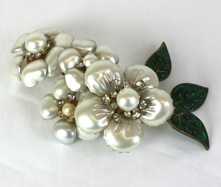 Rare, unique, single Chanel Camellia Ear Cuff made for the runway, likely an ending bridal look. Completely hand made by Maison Gripoix with a series of vari sized, hand made poured glass flower heads with mother of pearl lacquer, crystal paste
