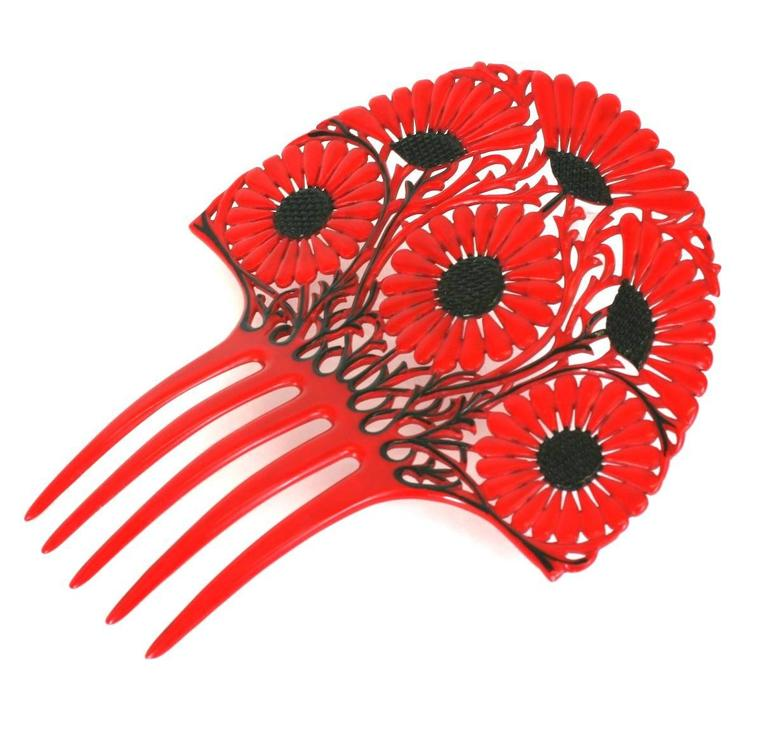 Art Deco French Celluloid Marguerite Hair Comb in red with black overpaint detailing. Strong Art Nouveau flavor in wonderful vibrant tones. 1930's France. Excellent condition.
