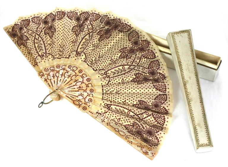 Charming Victorian Sequined fan with beautifully colored rasberry gelatin sequins. Incredibly ornate flower and leaf pattern on a sequin dot base, completely hand embroidered. Inlaid and dyed dots inserted on mother of pearl with bone stays. French