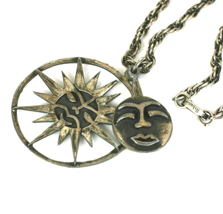 """Charming and unusual Rebajes Sun-Moon Pendant in patinaed silver metal. A """"face"""" charm swings over the larger base pendant. 1940's USA. Excellent condition. Chain 18"""". Pendant 2""""."""