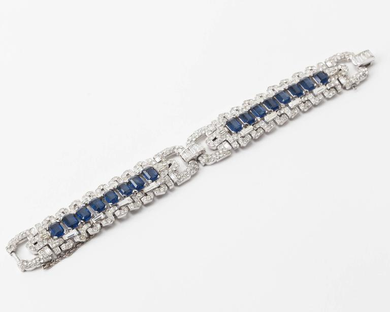 Spectacular Early Trifari Art Deco Bracelet from the 1930's in the high Art Deco taste. Beautiful quality designed likely by Alfred Phillipe for Trifari. Tight pave work with a row a central row of emerald cut faux sapphires. High rhodium finish.