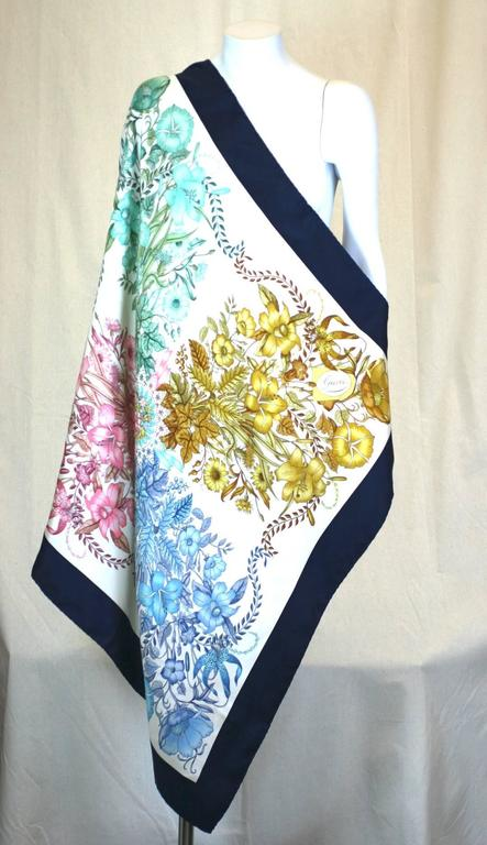 Gucci Floral Bouquet Scarf in silk twill. A series of similar bouquets in different tones are centered within a darker border. Excellent condition. 1990's Italy.