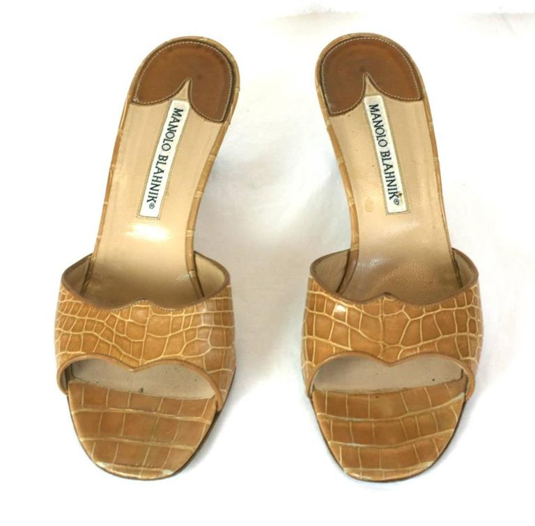 Manolo Blahnik's easy caramel crocodile slide mules with medium stacked heel.  From the Estate of actress, Ruby Dee. Excellent condition. Size 38. 1990's. .