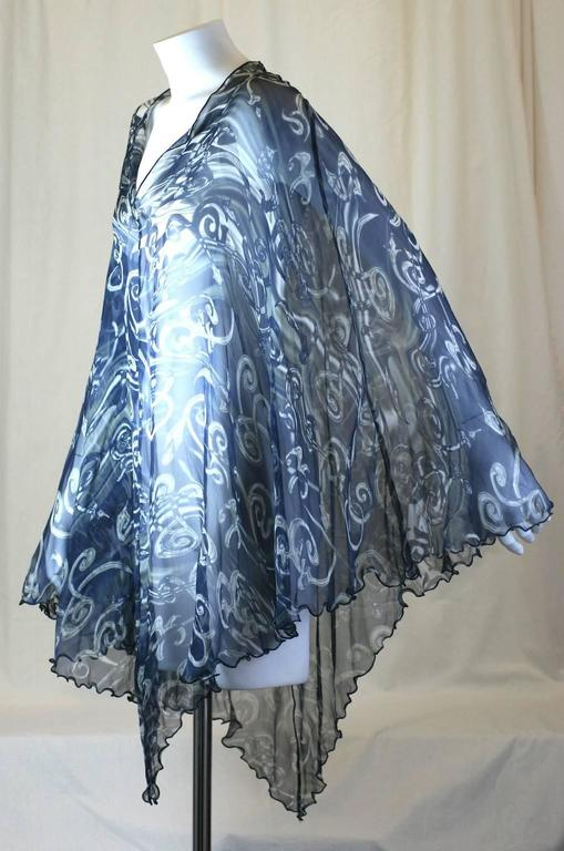 Salvatore  Ferragamo printed silk chiffon poncho. Printed swirling motifs in shades of white and gray on a navy background. Excellent Condition. Length 36