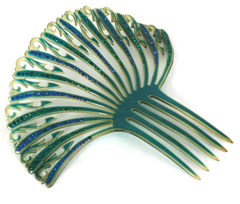 Elaborate Art Deco French openwork celluloid comb with green and blue pastes from the 1930's. Amazing colorations. France 1930's. Excellent condition. 