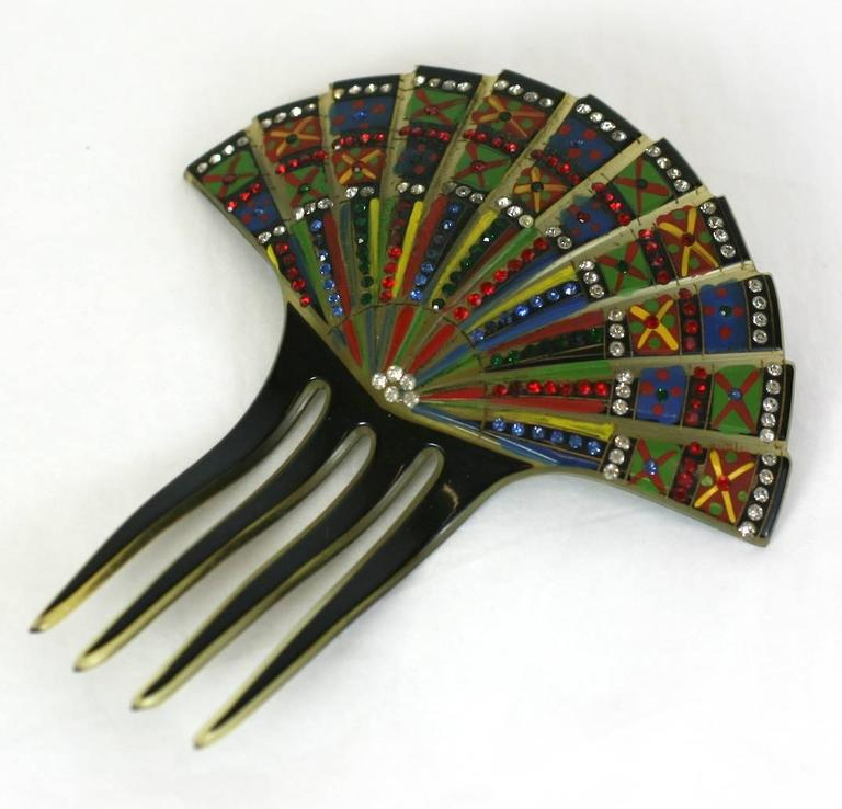 Eygptian Revival Art Deco Comb made in France 1920's. Cold enameled on celluloid and set with multicolored pastes. High quality and striking design. France 1920's. 