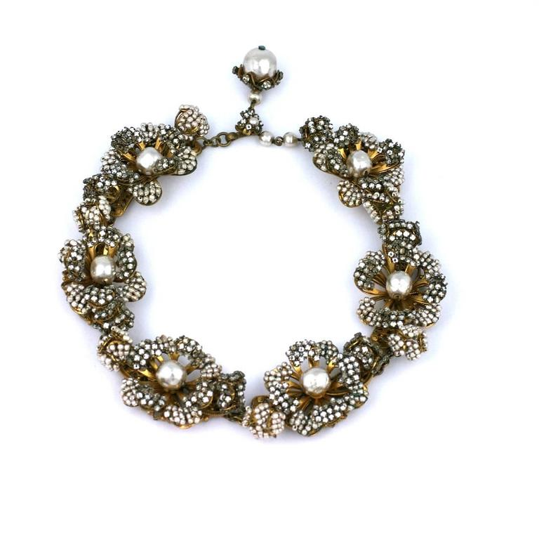 Collector quality Miriam Haskell Massive Rose Monte and Faux Pearl Flower Collar.  The 3 dimensional flowerheads are completely hand embroidered with rose monte crystals and tiny faux pearl beads. Each flower has a closed bud on each side, one