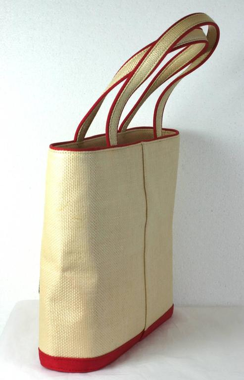 Charming Raffia and canvas tote by Lulu Guiness with embroidered,  vintage paper doll motifs. Zipper top entry with cotton lining. There's even a L.G. logo bag option as a cut out. Excellent condition. 1990's UK.