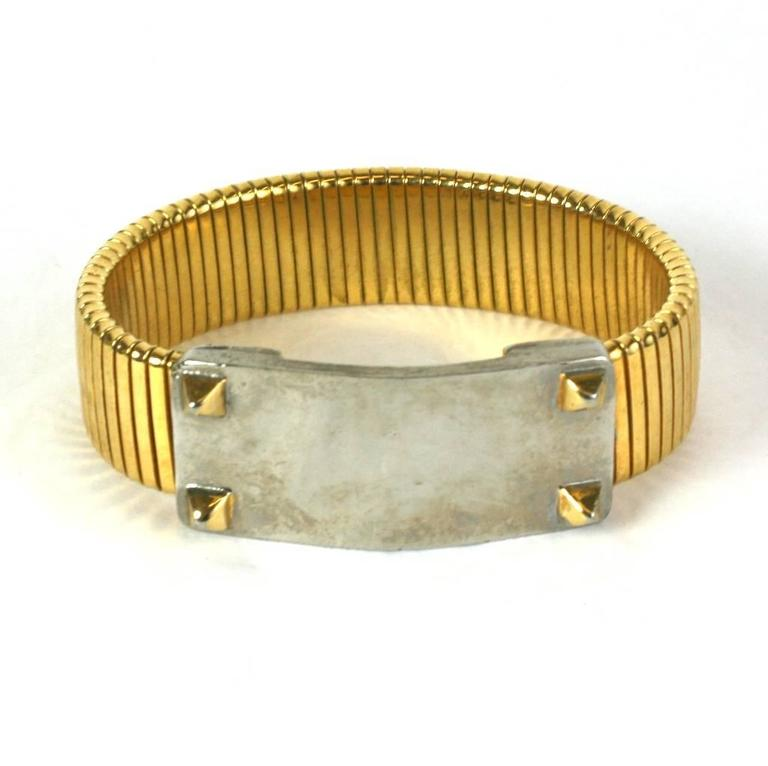 Studded Wristband Bracelet made by Accessocraft, NY. Silver toned motif is punctuated by gilt studs on matching gilt stretch band bracelet. 1980's USA.