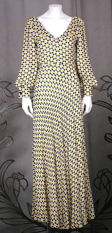 James Galanos vibrant, one piece polka dot crepe gown with flounced ruffle at neckline from the 1970's. Timeless styling and beautifully crafted with an ivory silk chiffon lining and bias piped edges and seams throughout. Bias cut crepe on bodice