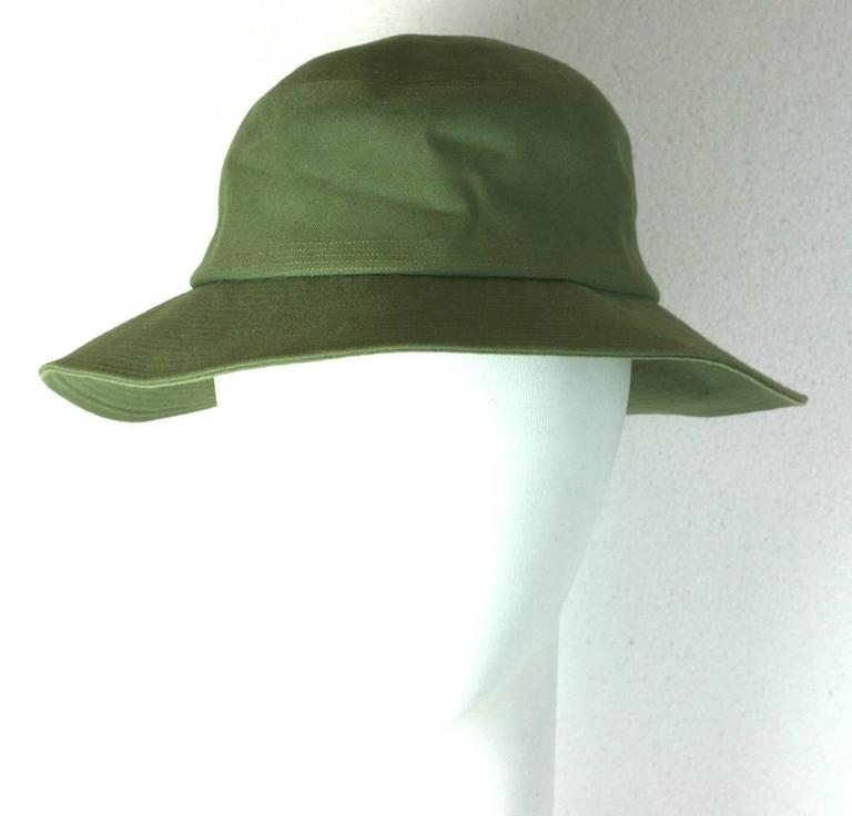 Yves Saint Laurent green cotton twill Fisherman's Hat with topstitched detailing throughout brim. A gallic interpretation where the brim is slightly wider in back as the original style would be. 
