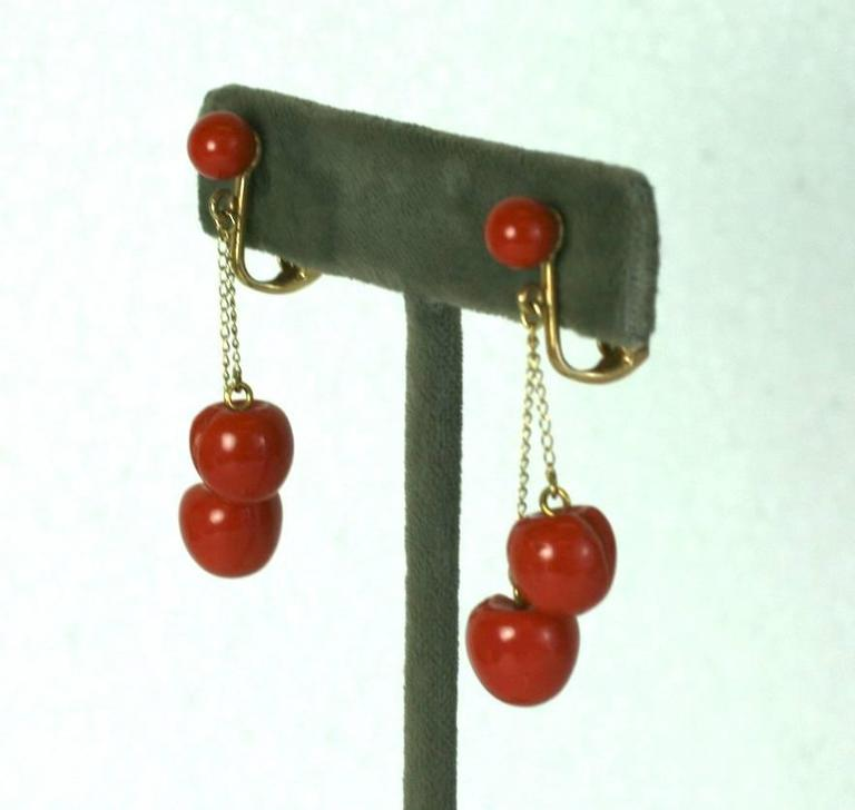 """Charming Coral """"Cherry"""" Earrings in 18k gold fittings. Nice coral color with a pair of carved """"cherries"""" on each earring. 1.75"""". Each cherry 10mm.  1950's Italy. Clip back fittings. Excellent condition."""