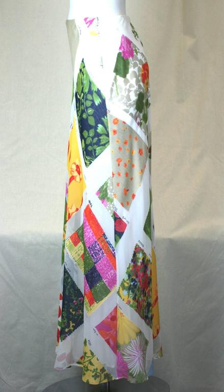 Moschino Cheap and Chic Printed Chiffon Fabric Swatch Skirt of vari color fabric sample swatches on a white ground. Bias cut for flow with silky white lining. Side zip entry. Polyester/Rayon. Excellent Condition, 2000's Italy.  Sizes: USA 6, Italy