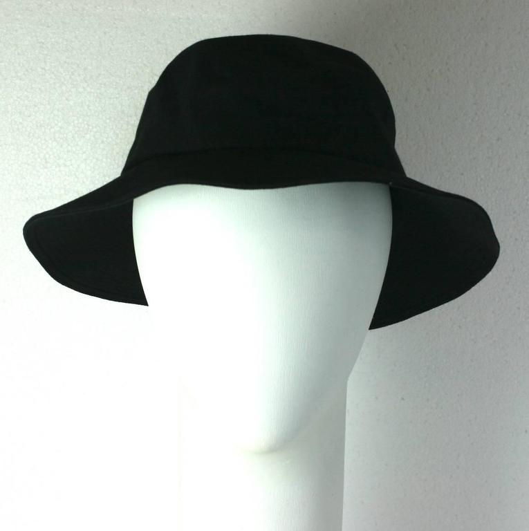 a93de48bf8c Yves Saint Laurent black cotton twill Fisherman s Hat with topstitched  detailing throughout brim. A Gallic