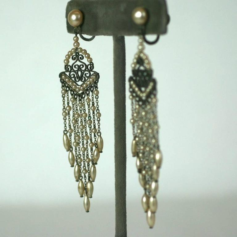 Attractive Art Deco faux pearl fringe earrings from the 1930's. Tiny faux pearls are strung on a pierced fretwork and off graduating chains. Screw back fittings. 1930's France. Excellent condition.  3.25