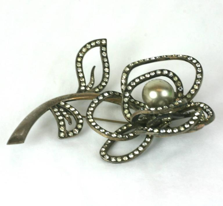 Massive, dimensional French abstract rose brooch of silver gilt metal, hand set crystal pave and focal faux silvered pearl. 1950's France. Excellent Condition.  Marked Depose.  4.50