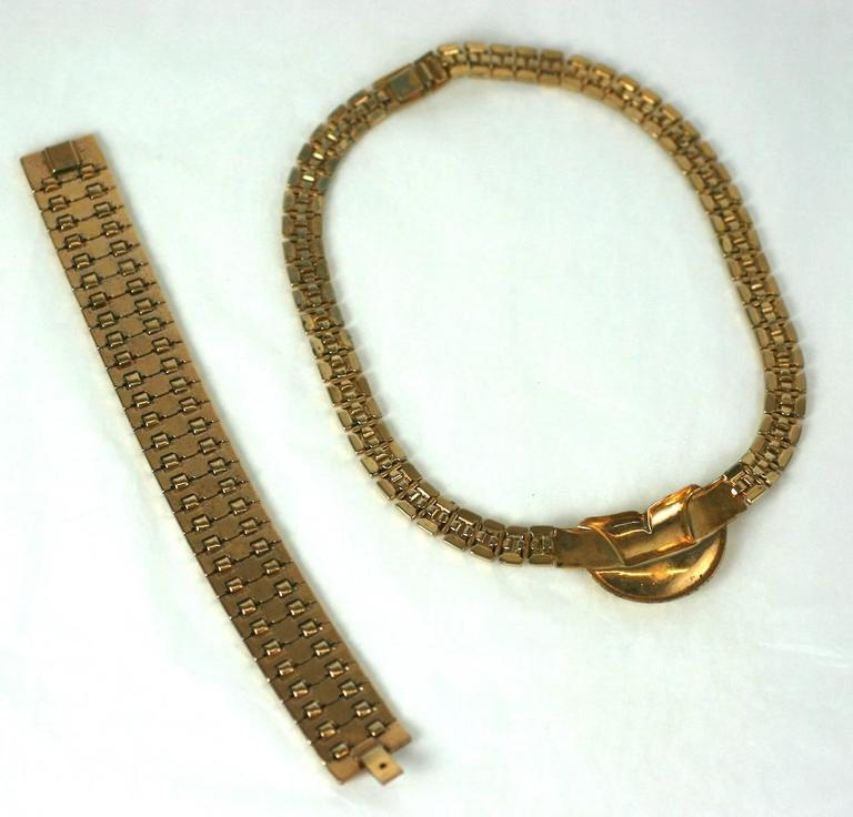 Attractive Trifari gilt suite with Retro link necklace and bracelet in the style of Van Cleef, from the 1940's USA. Excellent Condition. Length 15.50
