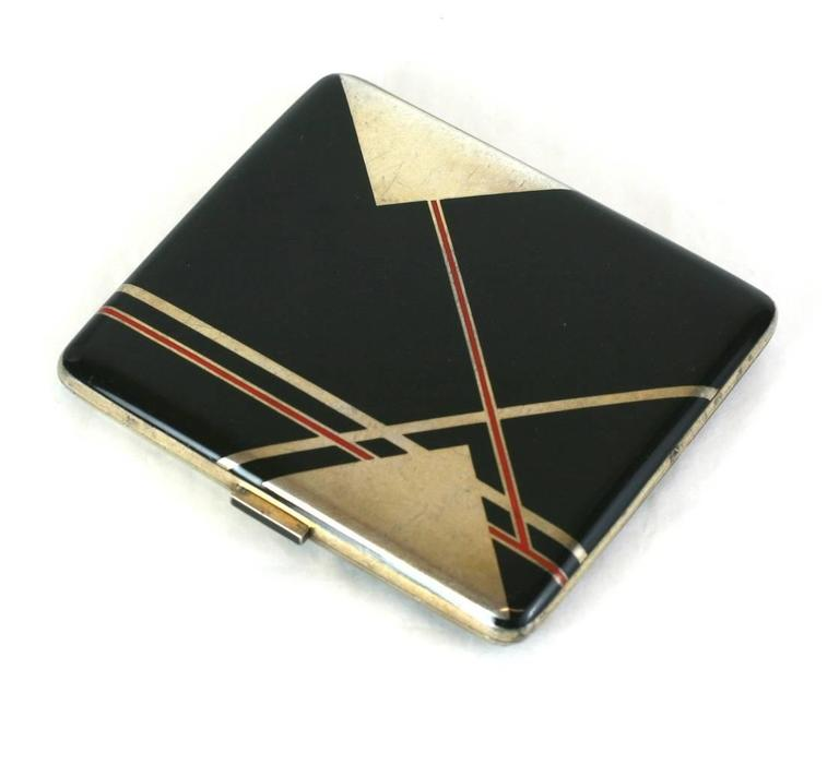 Art Deco Austrian enamel case circa 1920, of sterling silver with red and black hard enamel in a high style Cubist design. The negative triangular areas are the sterling base of the case. The fitted interior is gold washed. Marked,