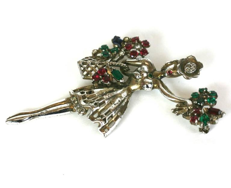 Retro Trifari Sterling Flower Seller brooch designed by Alfred Philippe. Charming subject matter showing a young girl selling jewel laden flowers from her basket. Brooch of gold plated sterling silver, crystal pave, vari cut, tricolor faux