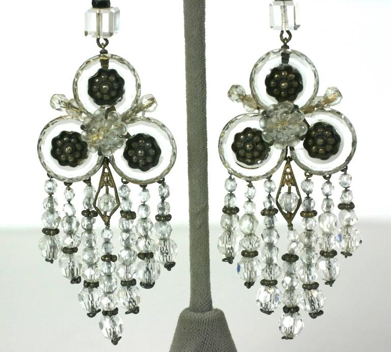 Amazing Art Deco Rock Crystal Fringe Earrings set in gilded silver. Wonderful and unusual design with fringes of rock crystal beads falling from 3 faceted crystal donuts with floral centers. A large molded glass flower centers each earring.