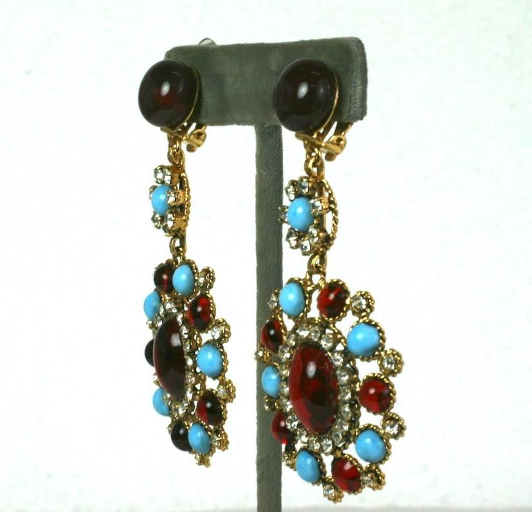 Elaborate and elegant Maison Gripoix Poured Glass earrings from the 1980's. Large scaled in vibrant contrasting tones of ruby and turquoise glass in a Baroque design set with crystal pastes throughout. All Gripoix manufacture from this period was