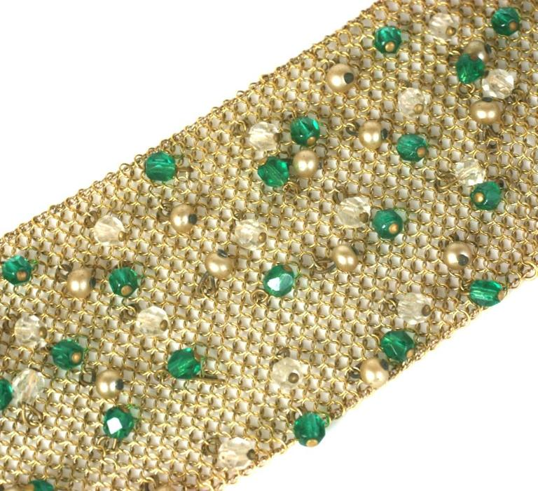 """Sandor Jeweled Mesh Bracelet from the 1950's. Gilt mesh is decorated with crystal and faux emerald faceted crystal drops which move with wearer. 1950's USA.  7"""" x 2"""" wide. Excellent condition."""