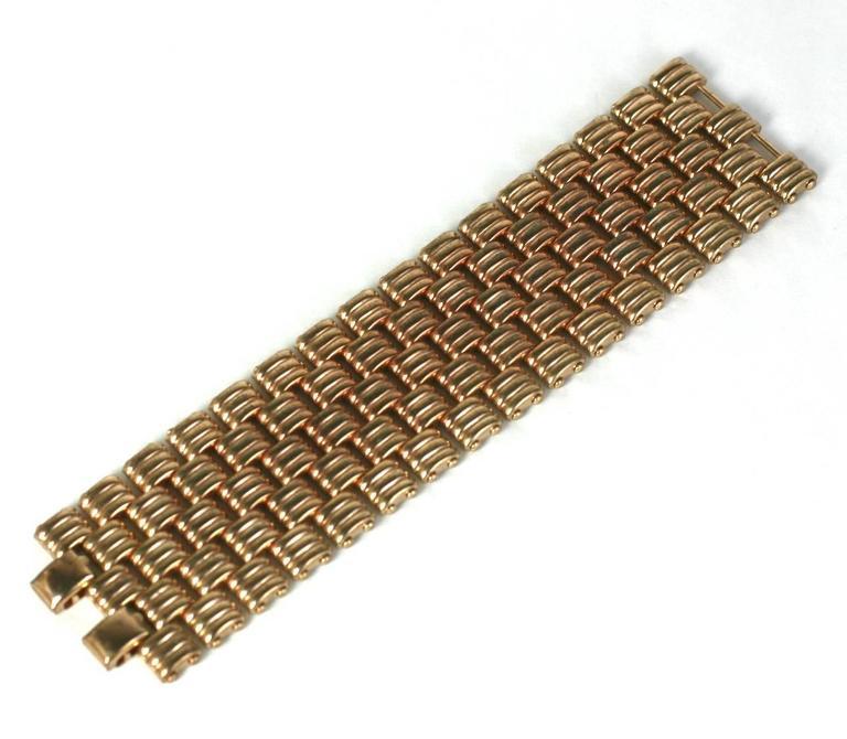 Kreisler Retro bracelet,of interlocking ribbed links, in rose gold metal.   Excellent Condition L6.50 W1.50