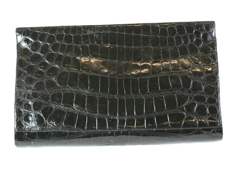 Manon Black Alligator Clutch with retractable silver chain handles. Simple elegant shape with central compartment and 2 side compartments for small items (chains are held here). Small marcasite stones trim the corners. 1960's USA.  Chains