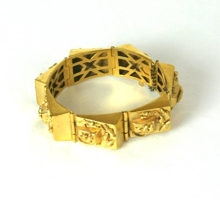 "French Retro style link bracelet. Composed of pyramidal stepped links in a rich gilt finish with unusual baroque style floral motifs. Excellent Condition.  1930's France.  Length 7.25"" Width .75"""