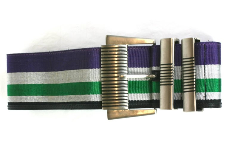 Gianni Versace woven striped belt. Large antiqued silver ribbed buckle with woven striped ribbon in shades of pale gray, green, purple with a band of fine black leather on one edge. Stamped Gianni Versace, Excellent Condition. Size Italian 70/ 28,