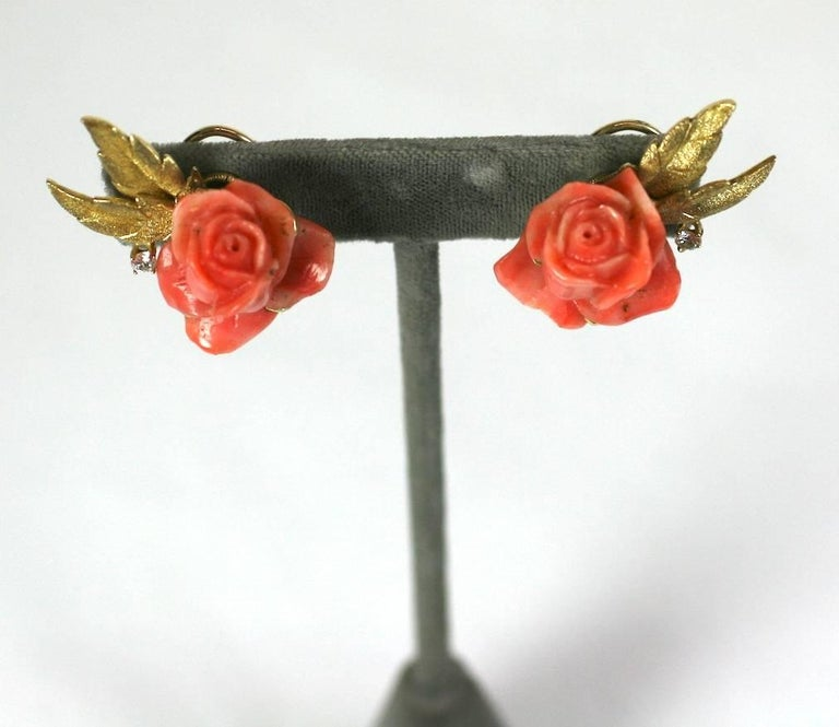 """Lovely Carved Coral Rose Earclips by Erwin Pearl in 18k gold with diamond accents. Deeply carved natural coral roses are framed by a pair of finely etched leaves and a single diamond on each earring.  Clip back fittings.  1960's USA.  1.5"""" x"""