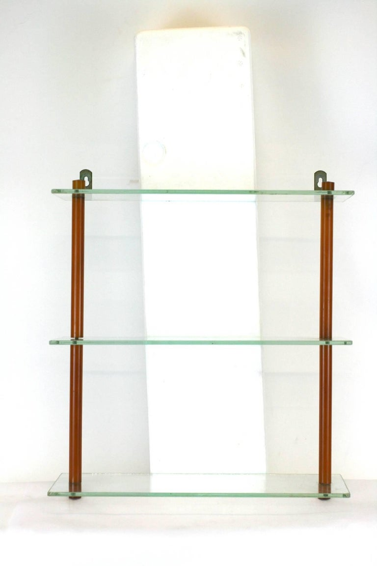 """Art Deco Bakelite Shelf, perfect for your display of bakelite barware and objects!  Glass shelves with caramel Bakelite clad metal rod supports.  1930's USA.  14"""" wide x 5"""" deep, 16"""" high.  Excellent condition."""