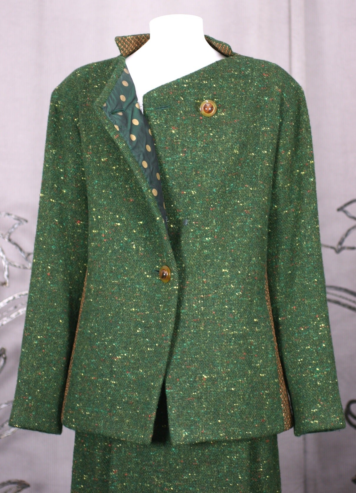 Geoffrey Beene Green Tweed Ensemble with inserts of open weave pink-peach tweed in signature body contouring cuts. Lined completely in green polka dot silk taffeta, Beene approached his sportswear with a luxuriant hand. 