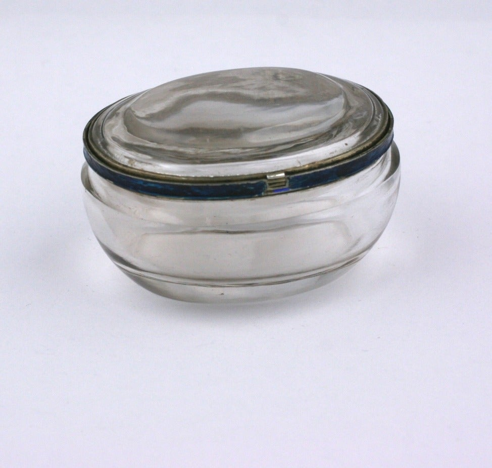 Rock Crystal and Enamel Pill Box from the turn of the 20th Century. Lovely quality, hand carved from 2 pieces of mineral rock crystal and joined by sterling and enamel fittings.  The original band of enamel was deep blue but has been replaced by a