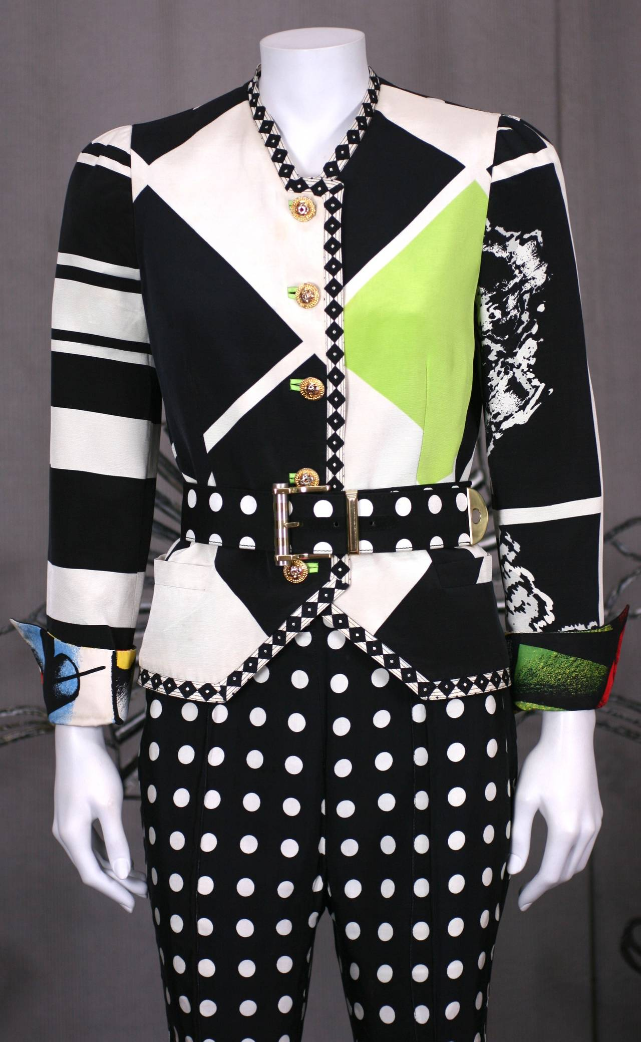 Gianni Versace's Black and White Graphic Suit with Pop Art overtones. Black and white geometrics and dots contrast with the brightly illustrated silk fashion