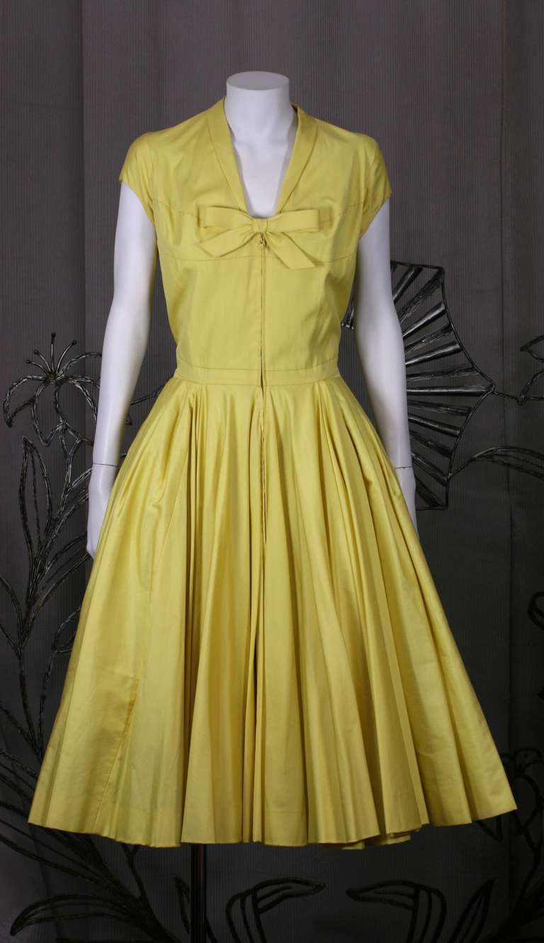 Citron glazed cotton sateen with intricate seaming throughout. Unlabelled.
