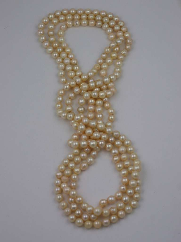 Lovely strands of cultured pearls in graduated lengths. The genuine cultured pearls are slightly baroque in form and measure between 7 and 8 mm. The 3 strands are endless (claspless) lengths of 26