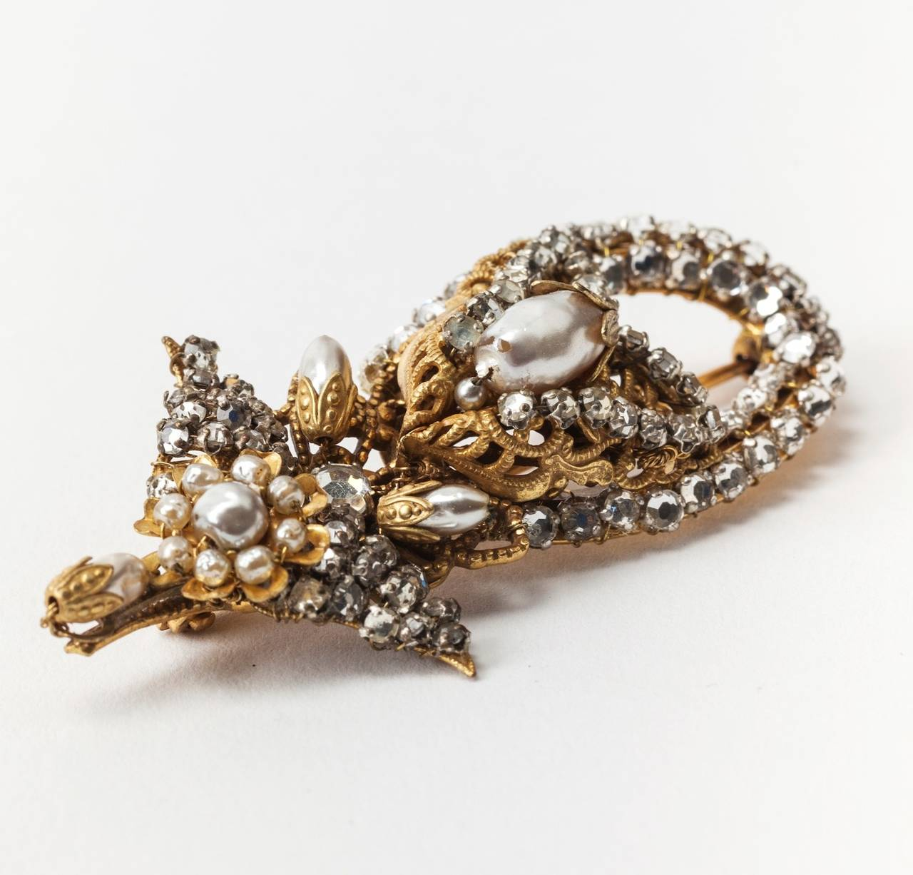 Miriam Haskell intricate brooch of signature rice and baroque faux pearls with crystal rose montes, set in signature Russian Gilt filigree . Note: Available companion piece to Miriam Haskell pearl and crystal ring. 1950's USA. 2.5